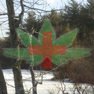 Lovely medical cannabis symbol over winter lake photo.